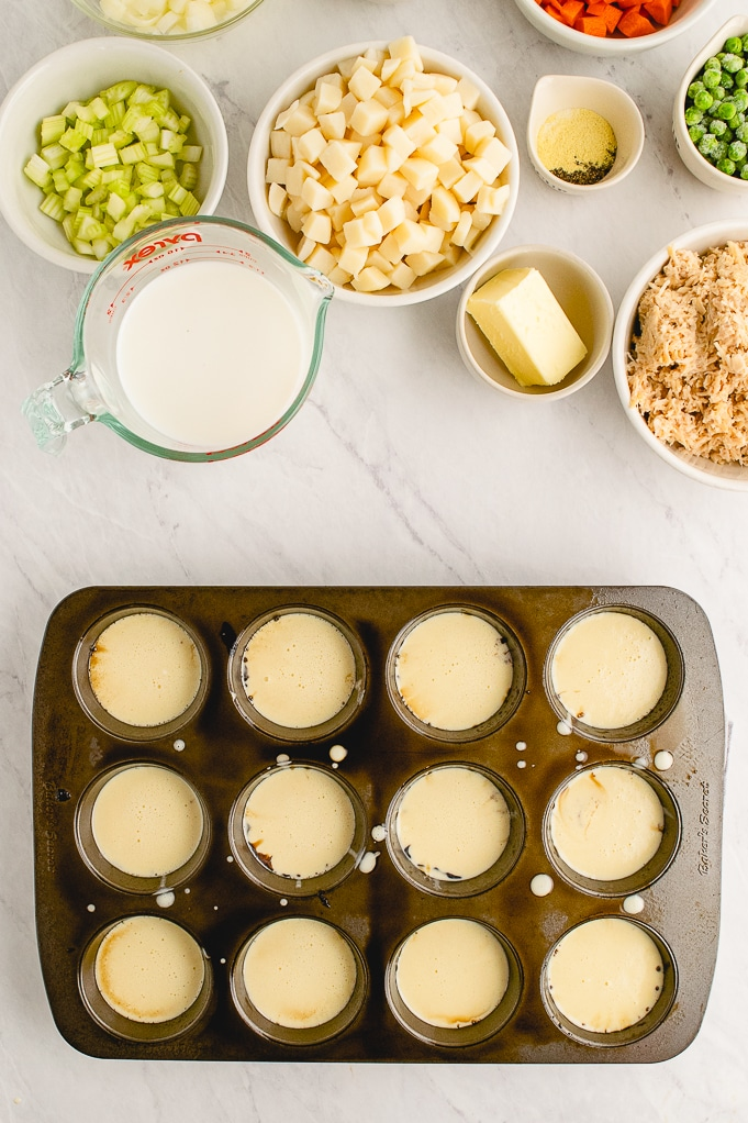 Popovers in a muffin pan ready to bake.