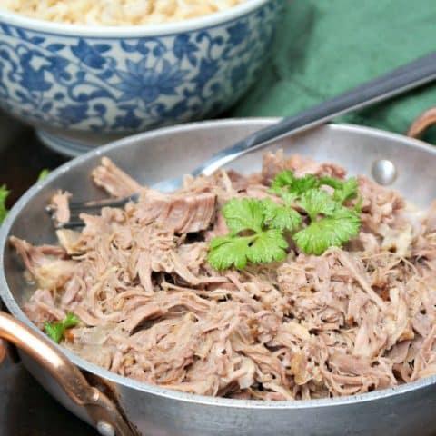 Kalua Pork shredded in a silver serving plate