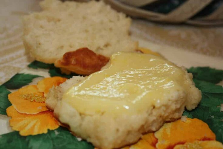 lemon curd spread over homemade biscuits