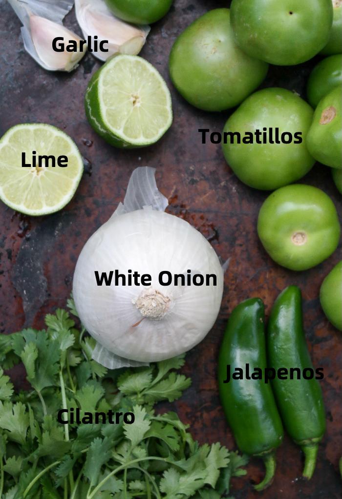 Ingredients to make tomatillo salsa verde.