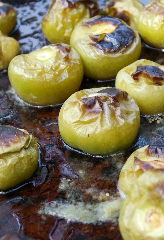 Roasted tomatillos in the oven to make salsa verde.