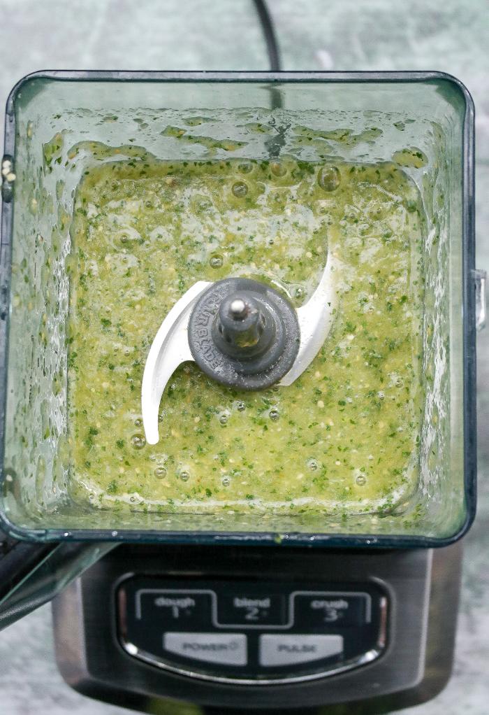 Blended tomatillo salsa verde.