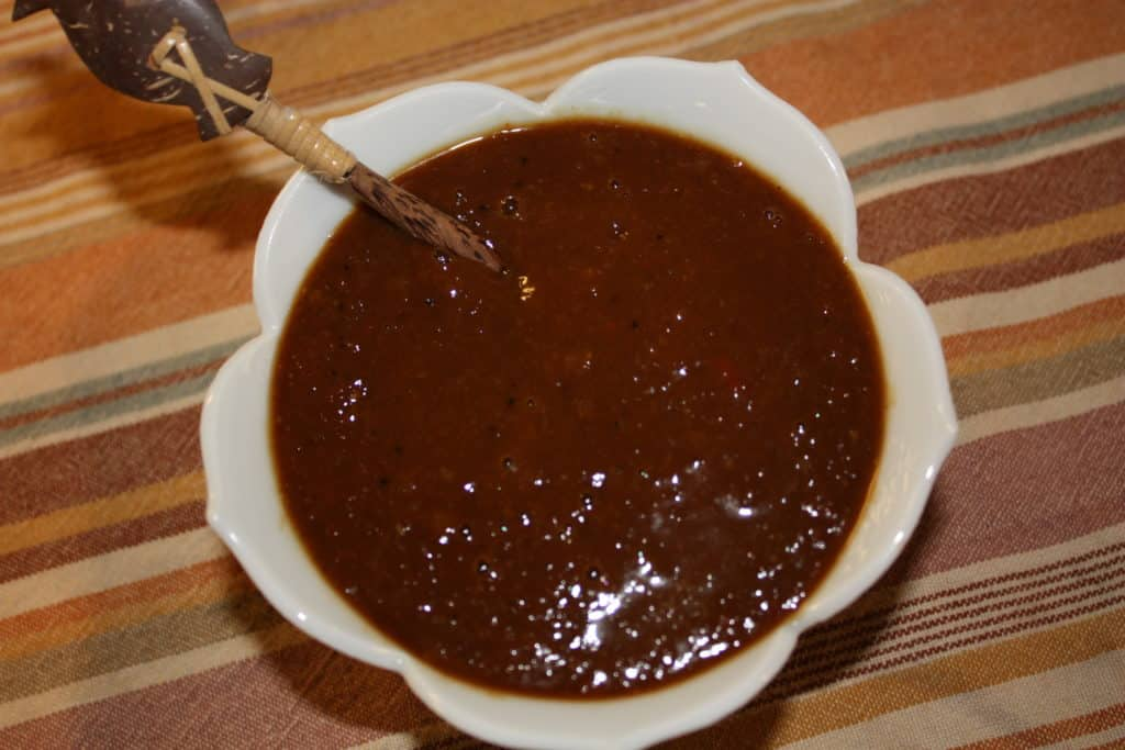 Homemade mango barbecue sauce in a small white bowl
