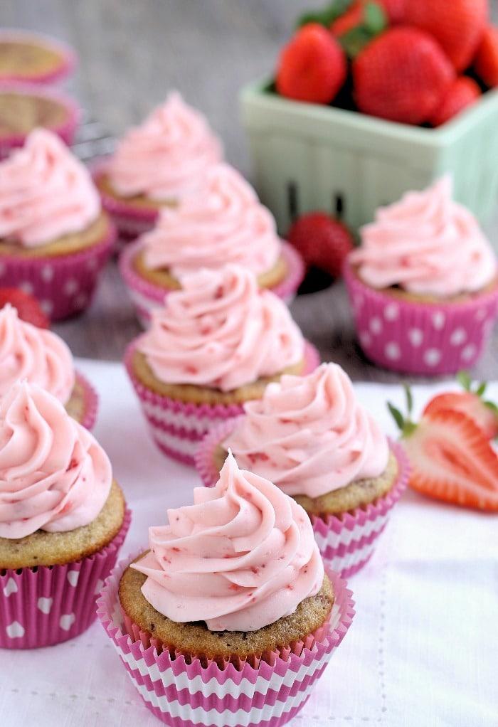 Strawberry cupcakes on a white napkin ready to be eaten