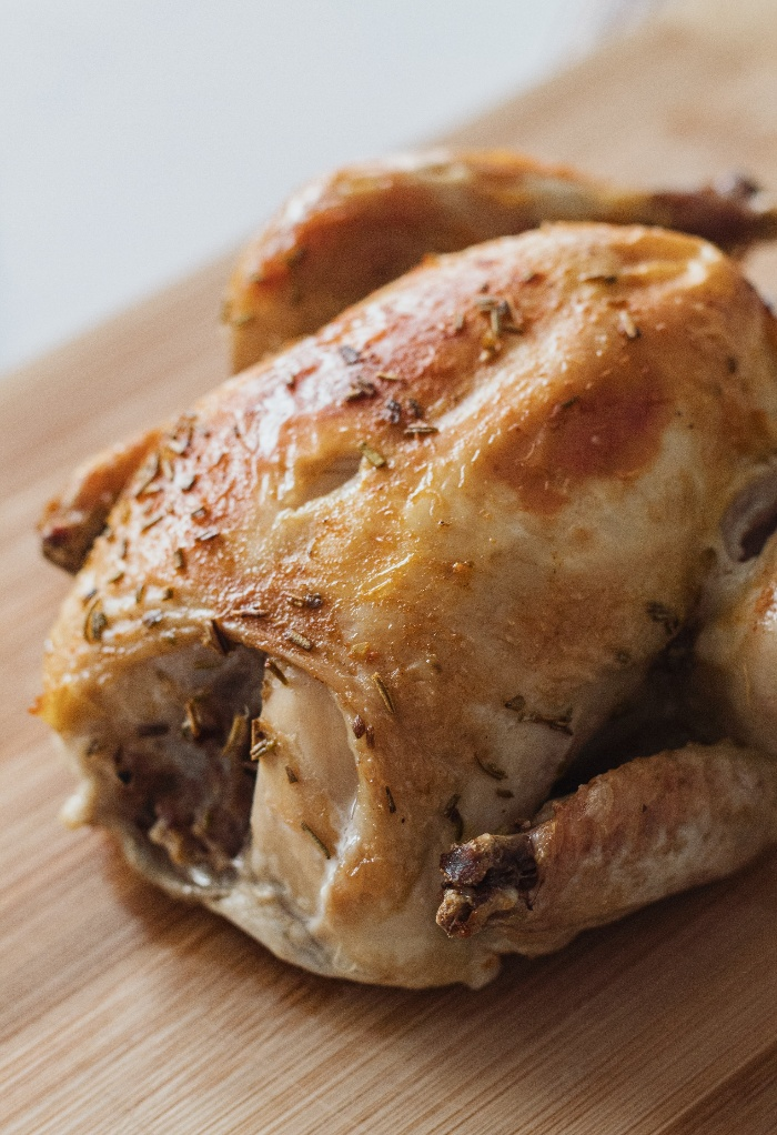 Roasted chicken on a cutting board.
