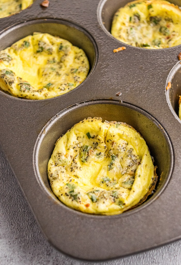 A muffin tin with baked egg cups.