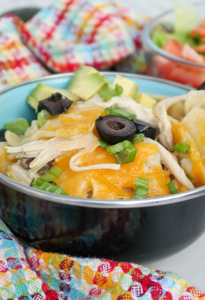 A black bowl filled with enchilada skillet meal.