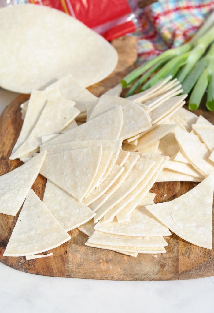 Corn tortillas sliced in triangles.