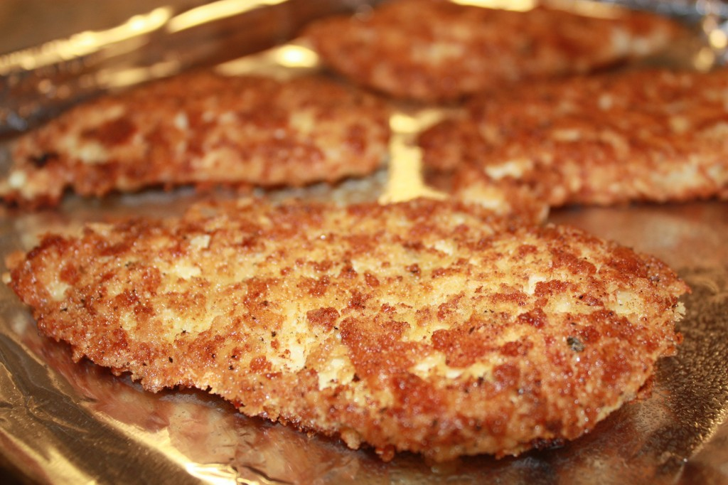 The Best Chicken Parmesan filets lightly fried and then baked to perfection | www.thefoodieaffair.com