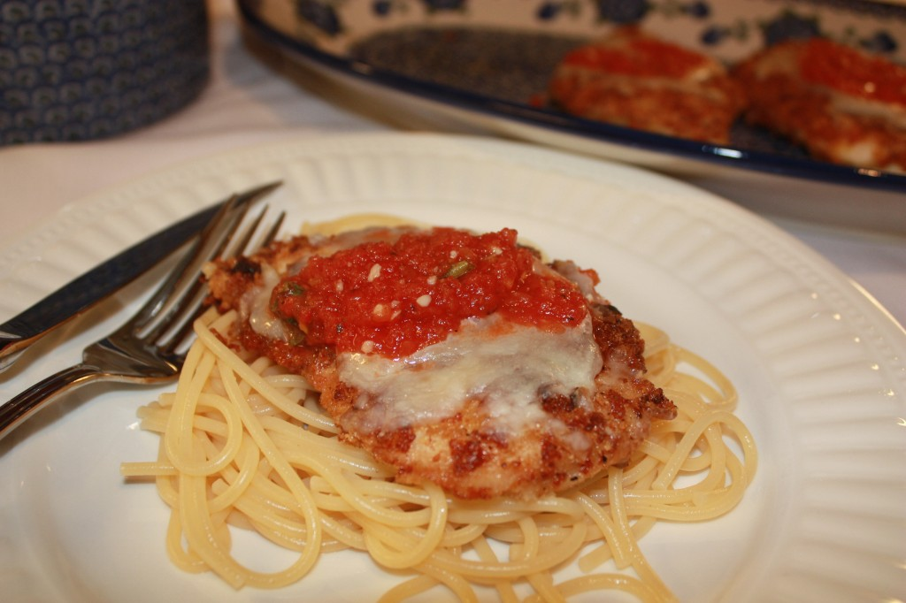 The Best Chicken Parmesan served over a bed of pasta! | www.thefoodieaffair.com