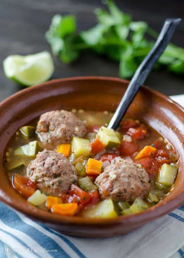Albondigas with vegetables in a brown bowl