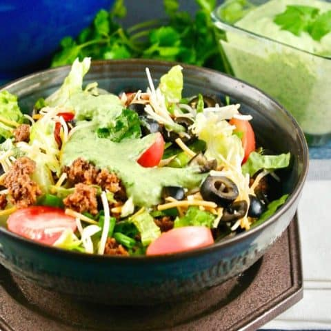 Taco salad in a brown bowl