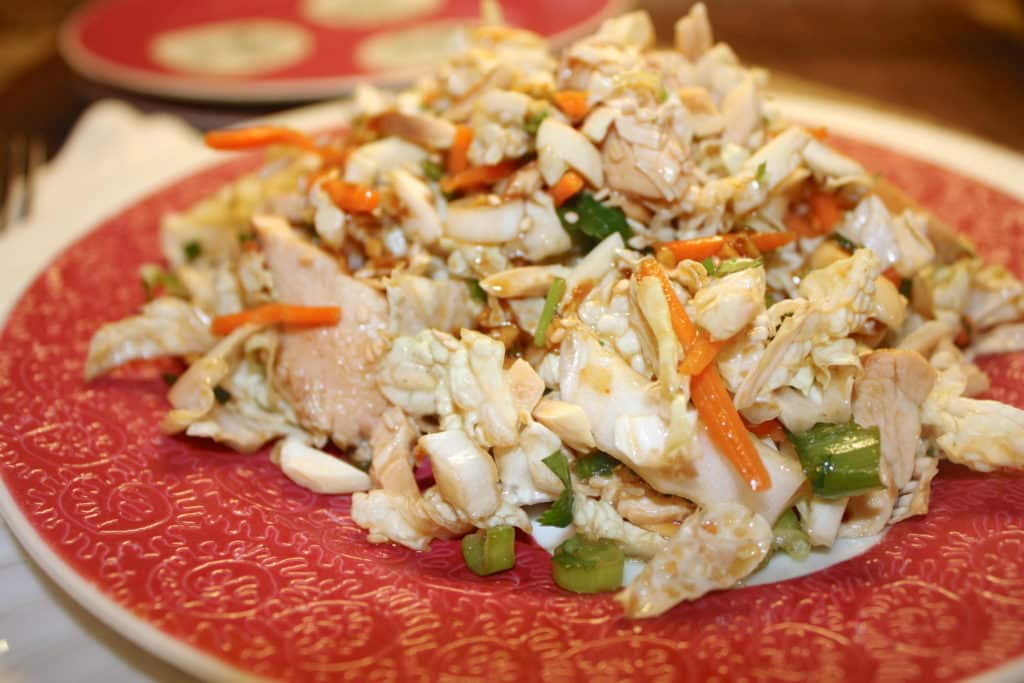 grilled chicken salad on red plate