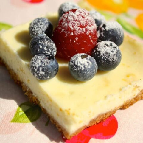 Lemon cheesecake topped with fresh berries.