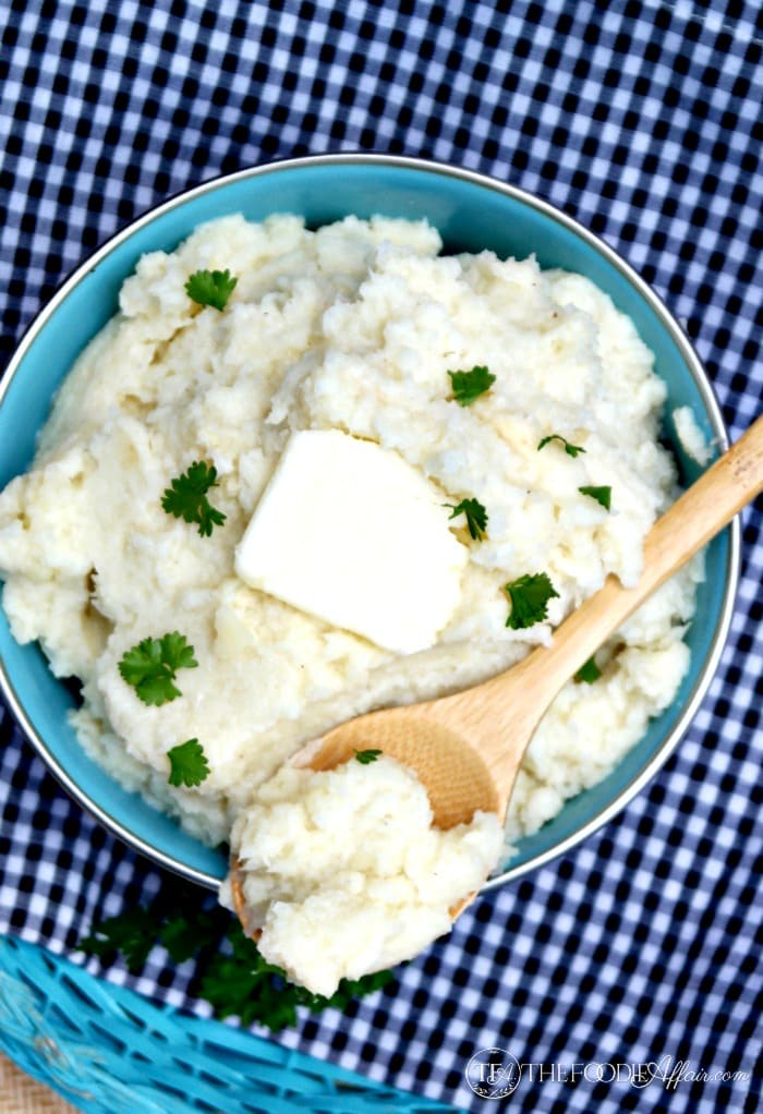 Mock Mashed Potatoes in a blue bowl with butter