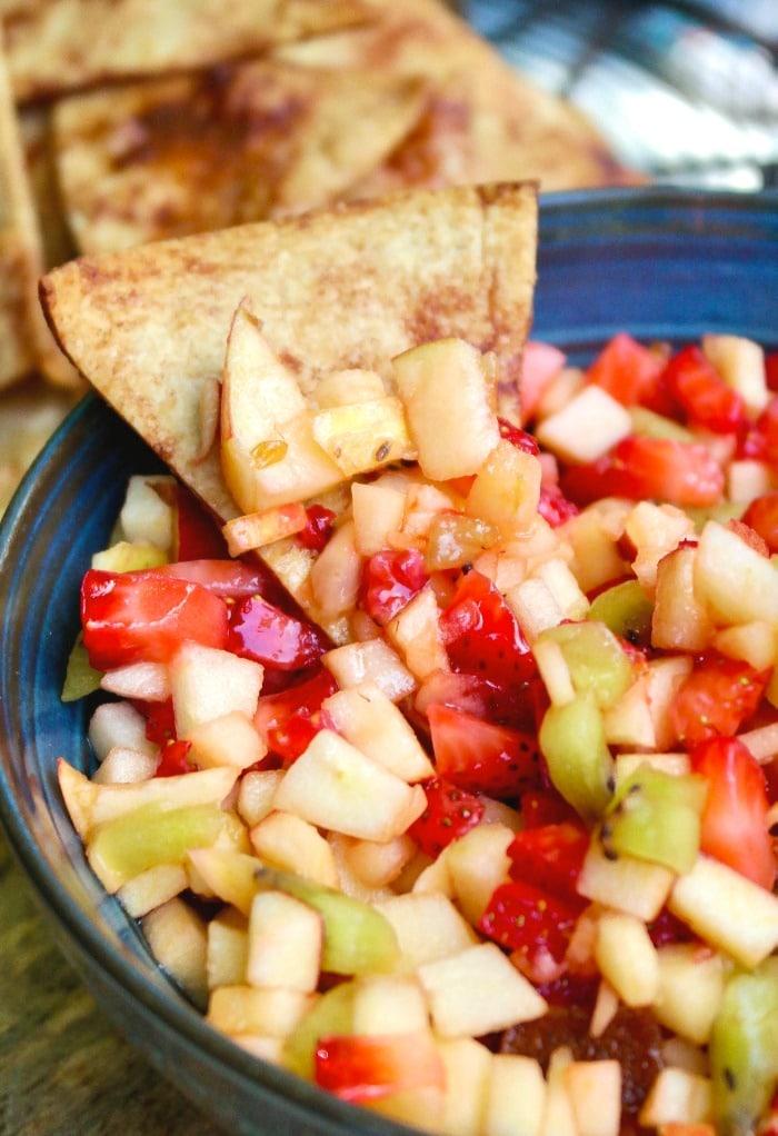 Fruit salsa dip with a cinnamon chip.