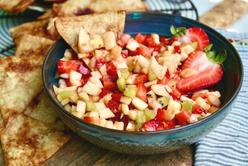 A blue green bowl of fresh fruit salsa.
