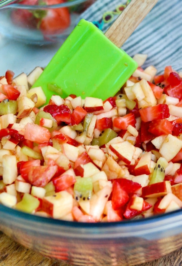 Fruit salsa mixed with all the ingredients ready to be placed in a serving bowl