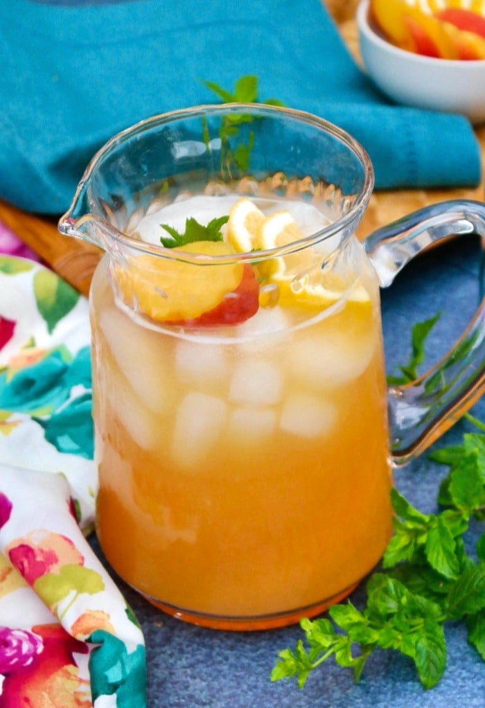 Pitcher filled with fresh peach lemonade