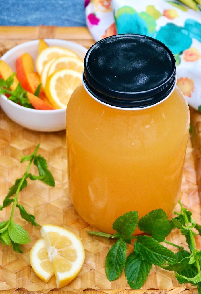 Mason jar filled with homemade peach lemonade