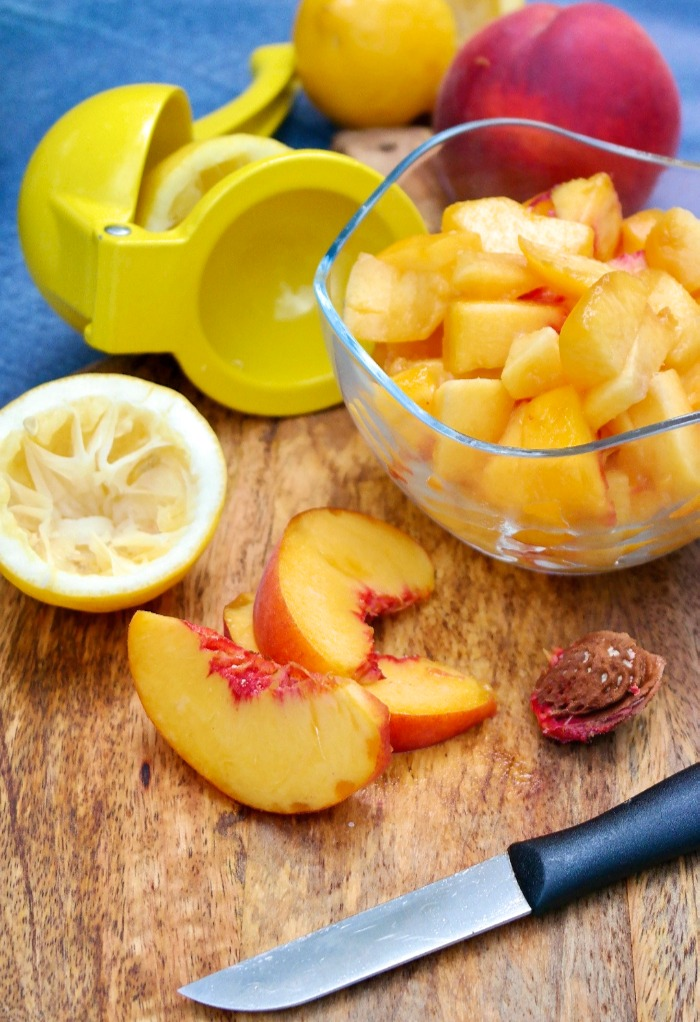 Fresh diced peaches on a cutting board