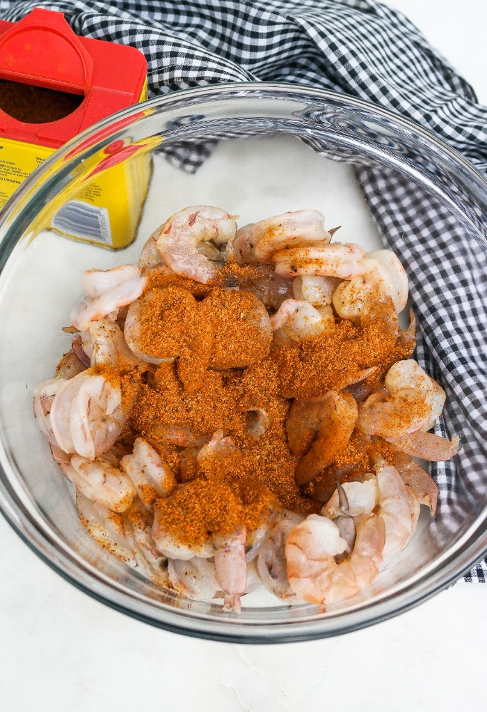 Shrimp in a clear bowl with spices.