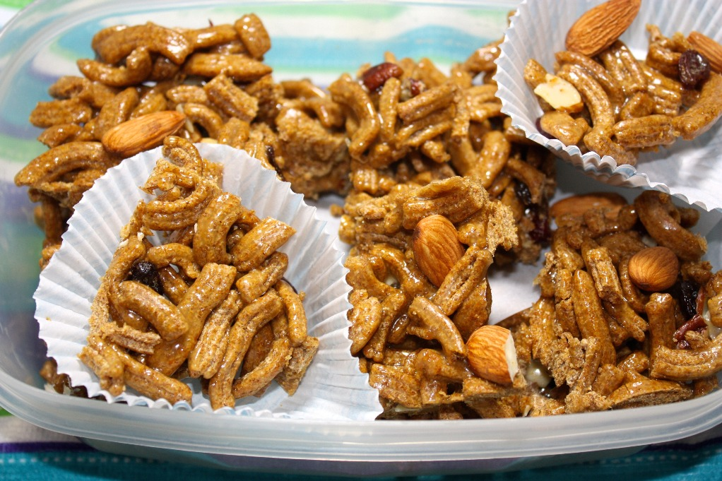 cereal bar clusters in a baking liner placed in a plastic container
