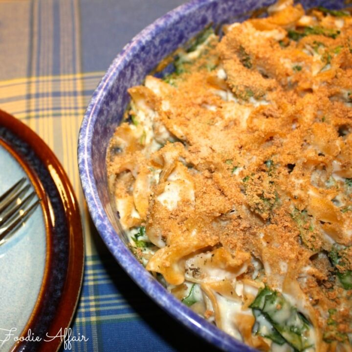 chicken casserole dish with spinach in a blue serving dish