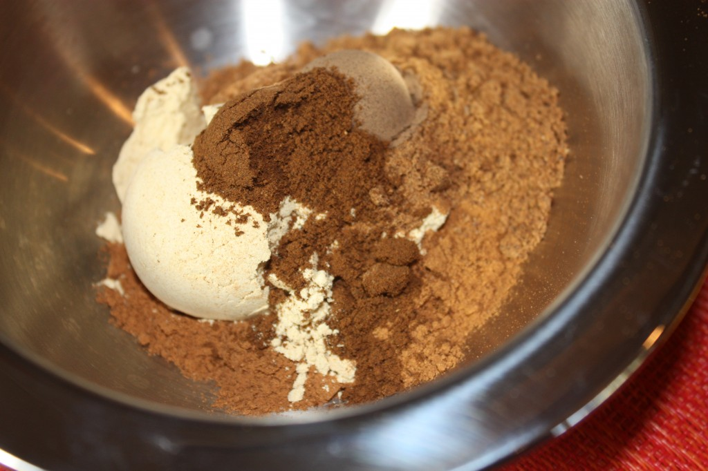 all ingredients for pumpkin pie spice in a stainless steel bowl