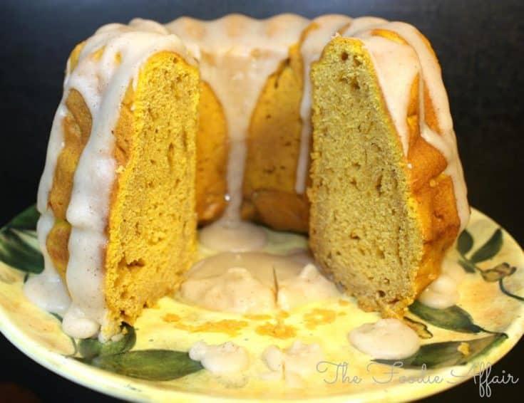 Pumpkin pound cake with a sugar glaze on a yellow flowered plate