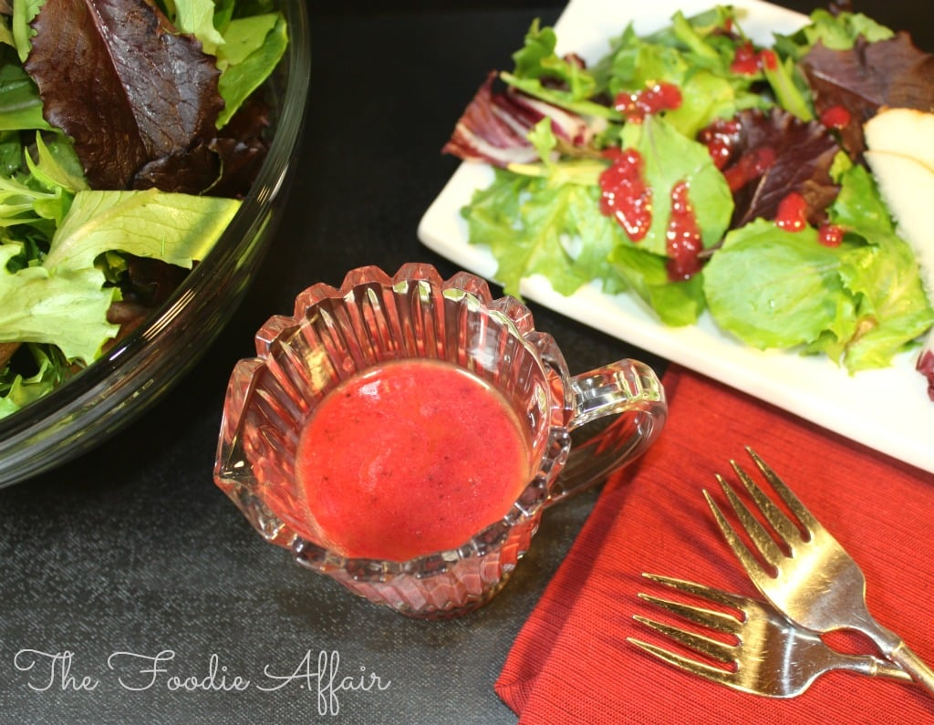 Bright cranberry vinaigrette dressing in clear bottle