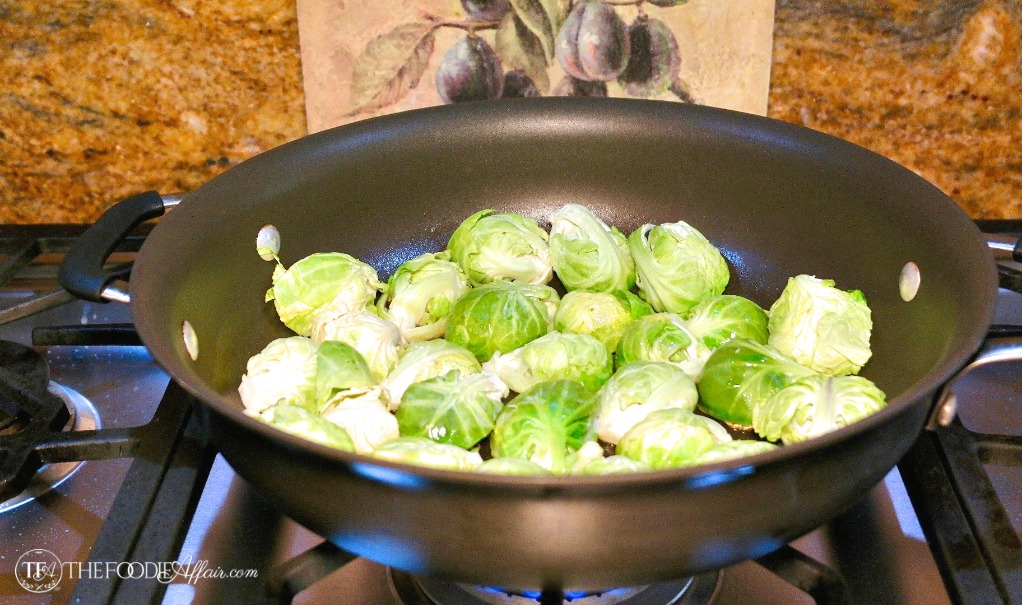 cooking maple glazed brussels sprouts in a skillet