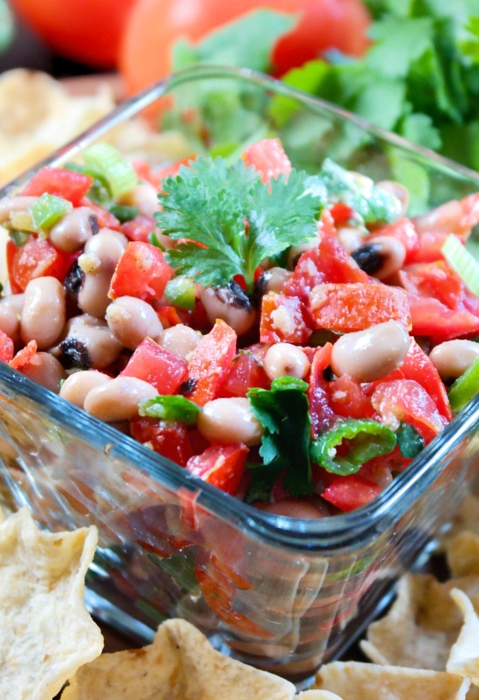 Close view of Black-eyed pea dip in a clear bowl.