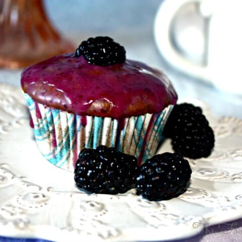 Blackberry Yogurt Muffins on a white plate
