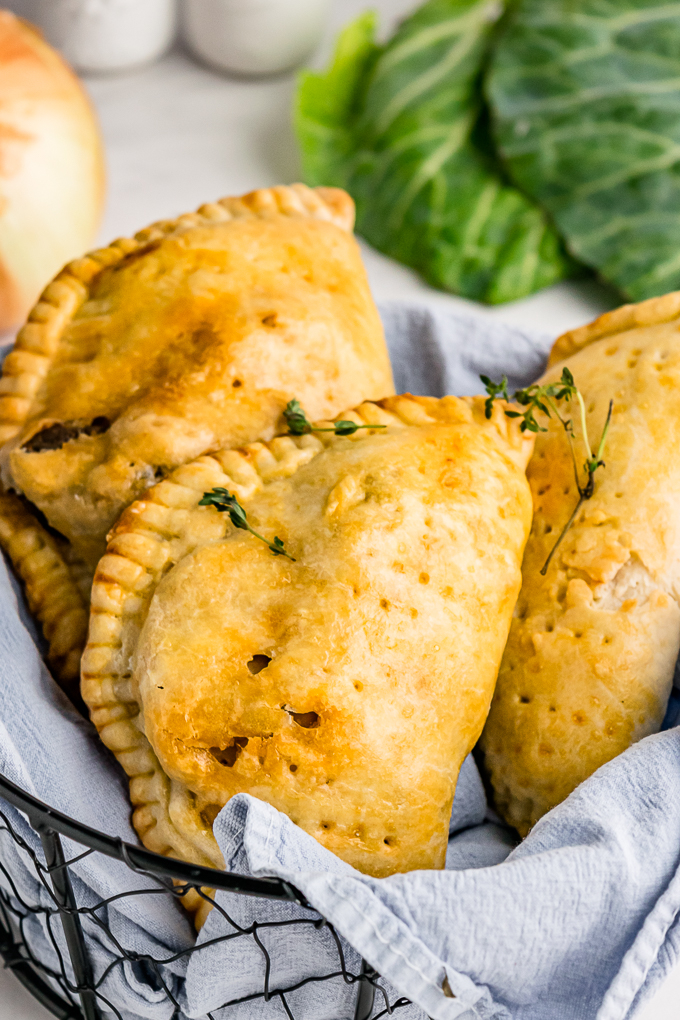 Meat hand pies in a basket ready to eat.