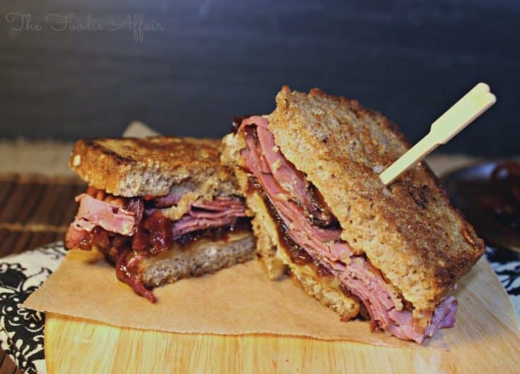 Grilled pastrami sandwich on a cutting board