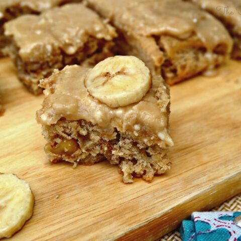 Browned Butter Banana Cake sliced on a cutting board