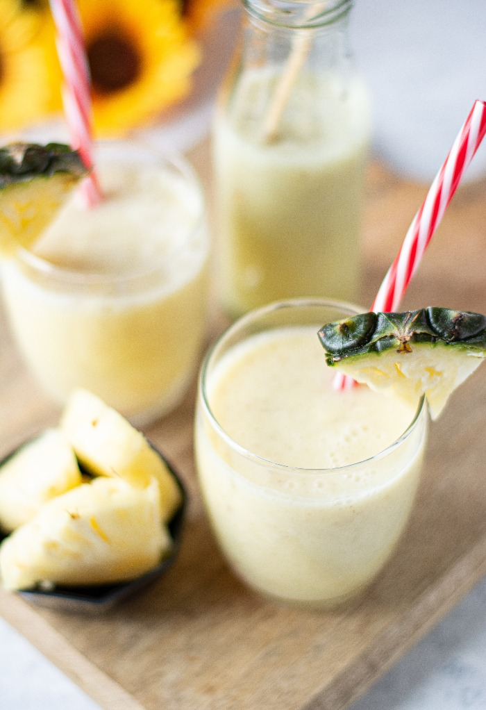 Clear glasses filled with pineapple smoothies
