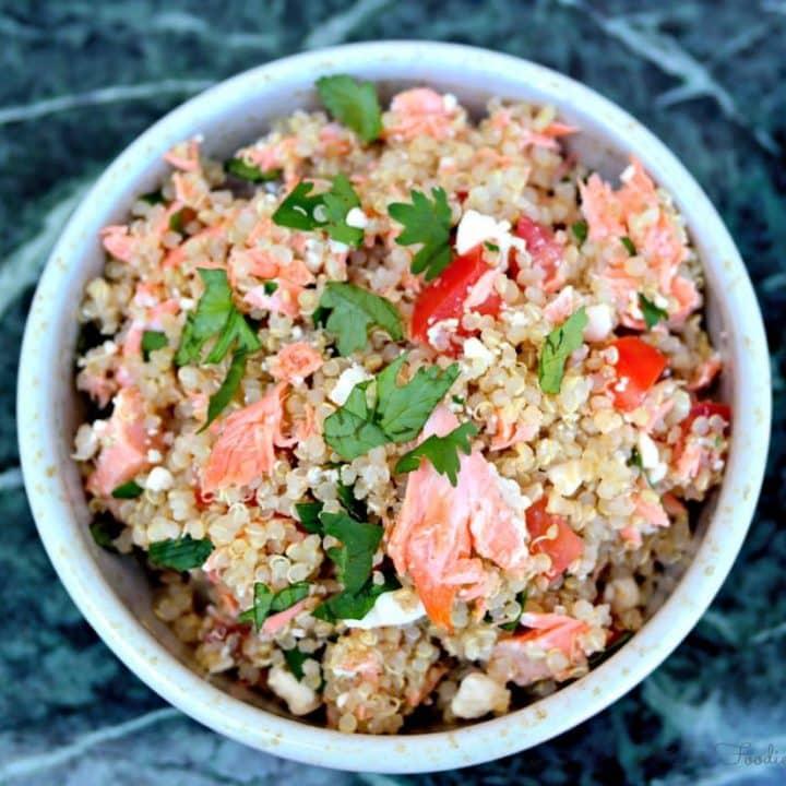 Quinoa Salmon Bowl in a white bowl topped with cilantro