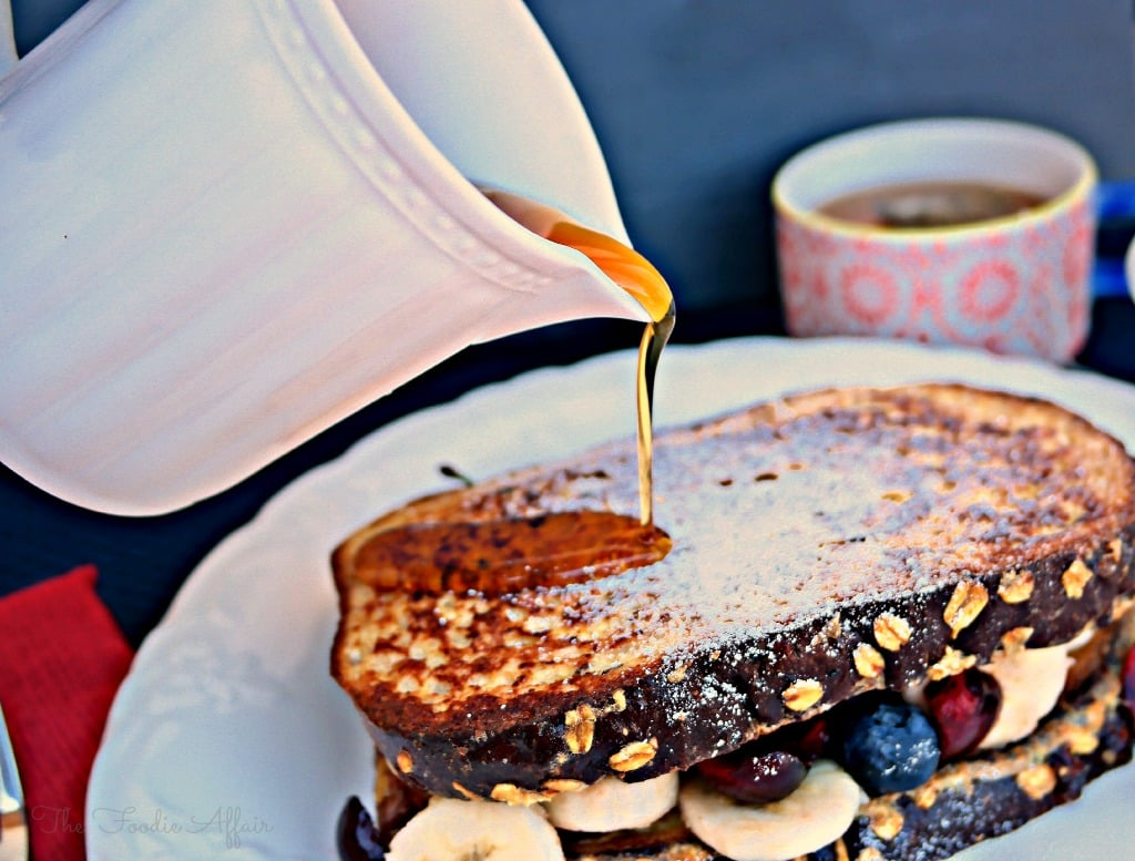 High Protein French Toast Sandwich with maple syrup on a white plate.
