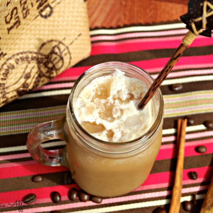 Homemade frosty cappuccino in a mason jar ready to be drank