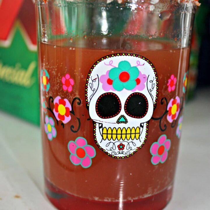 Michelada Recipe in a colorful glass with a skull