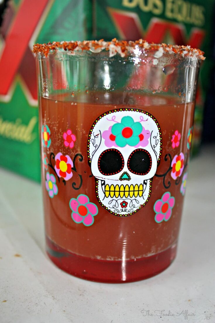 Michelada Recipe in a colorful glass with a skull