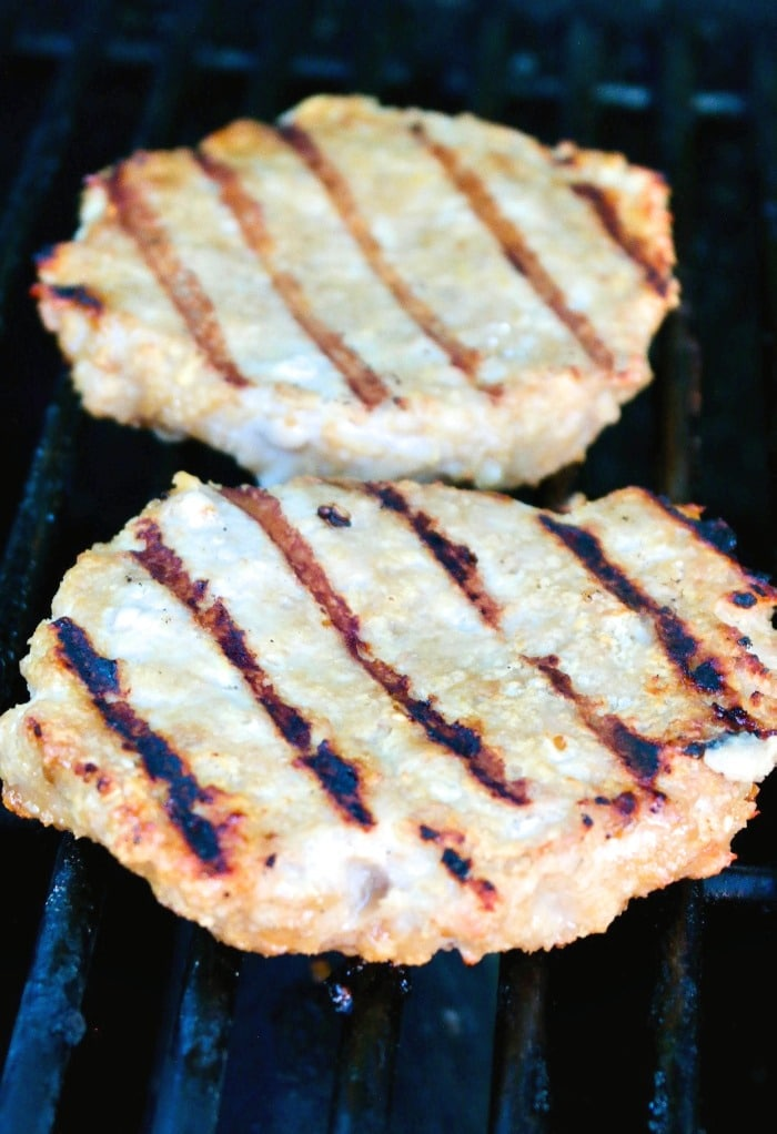 Grilled turkey burgers on a hot grate.