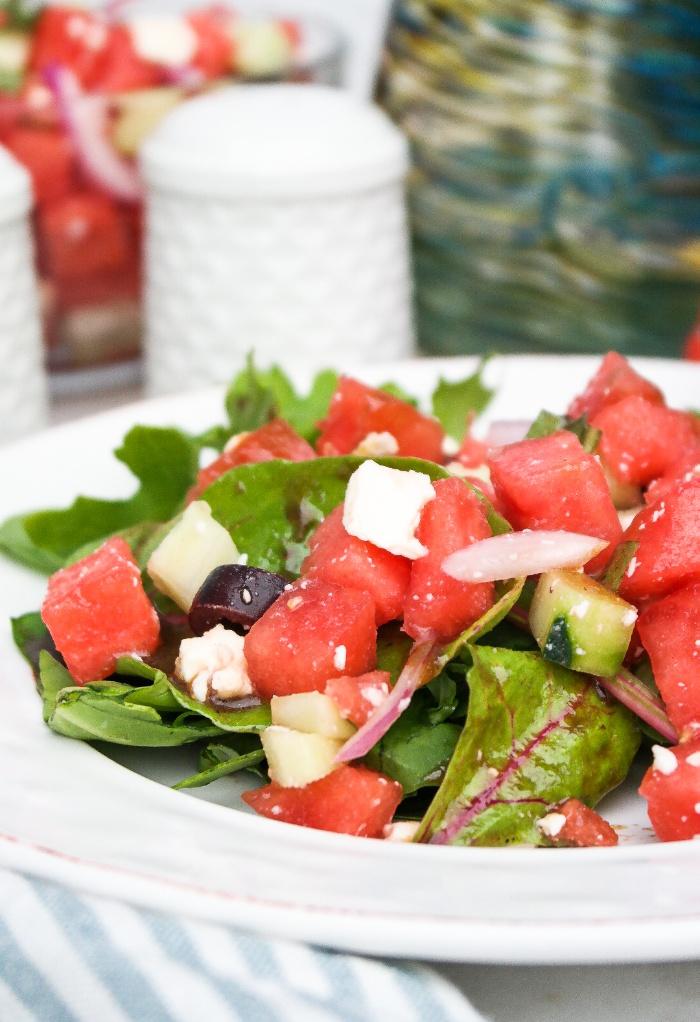 Mediterranean watermelon salad on a white plate.