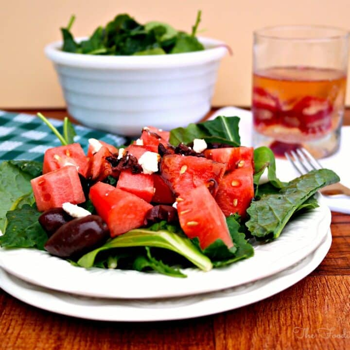 Mediterranean Watermelon Salad on a white plate ready to be eaten