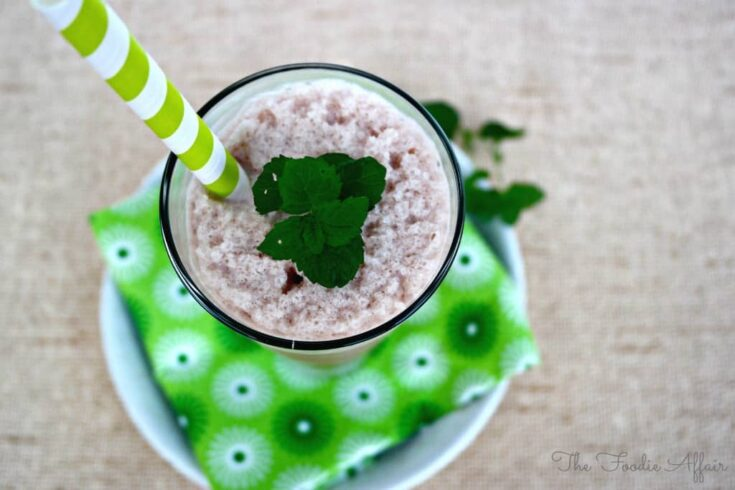 Chocolate Mint Protein Smoothie with a green straw
