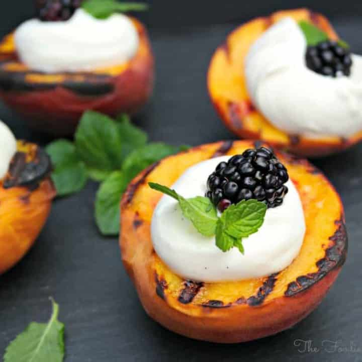 Grilled Peaches and Yogurt Cream with a fresh blackberry in the center