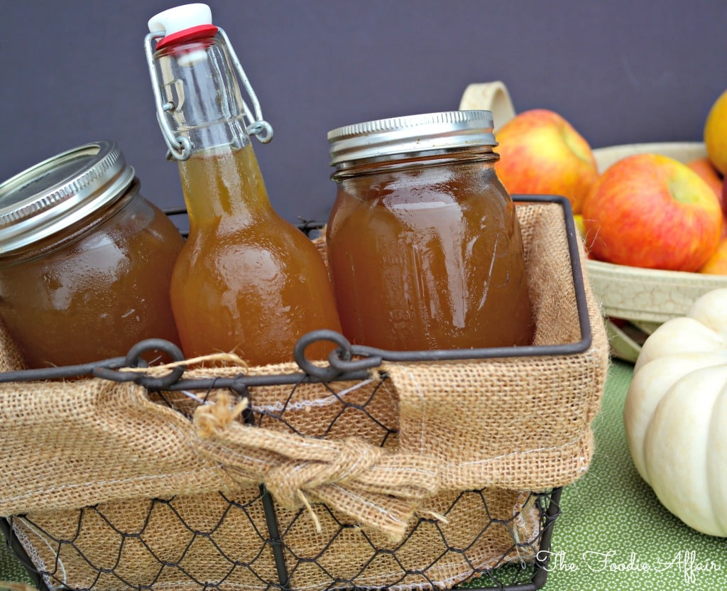 Apple Pie Moonshine  in a wire basket to be given as gifts.