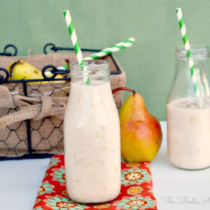 Pear Smoothie in clear milk jars with green straws